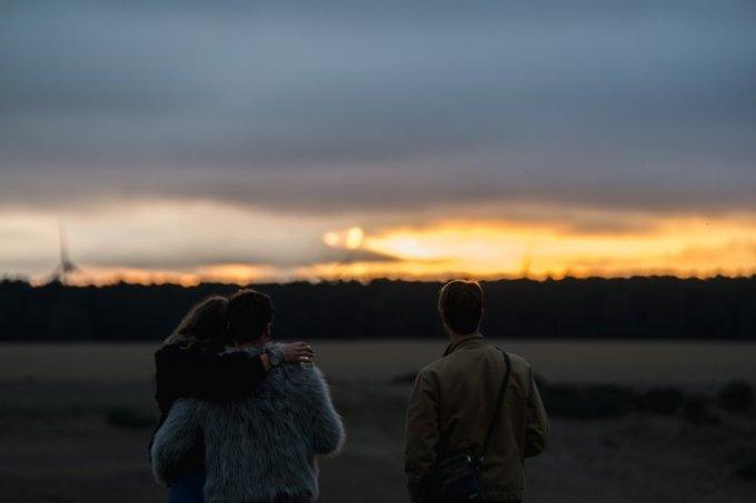 revellers-watch-the-sun-set-over-golden-plains